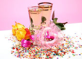 Wine and rose on pink — Stock Photo