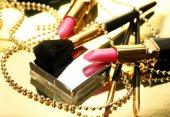 Decorative cosmetics with beads — Stock Photo
