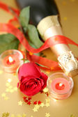 Champagne, candle and rose — Stock Photo