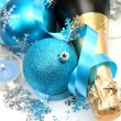 Champagne and decorative spheres — Stock Photo #76315011