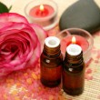Aromatic oil and rose and candles — Stock Photo #76314839