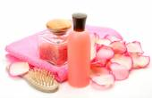 Pink towel with body care subjects — Stock Photo