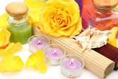 Scrub with flowers and candles — Stock Photo