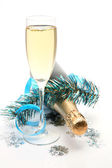 Champagne and tinsel on white — Stock Photo