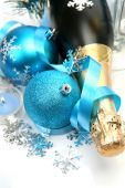 Champagne and decorative spheres — Stock Photo