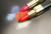 Red and pink lipsticks — Stock Photo