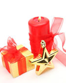 Holiday present box and candles — Stock Photo