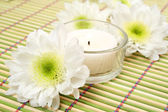 Flowers with candles as decoration — Stock Photo