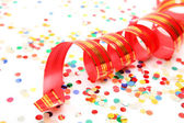 Confetti and red streamer — Stock Photo