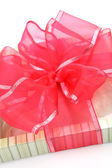 Gift box with a red  bow — Stock Photo