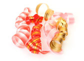 Pink and golden streamers — Stock Photo