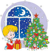 Boy with a Christmas gift — Stock Vector