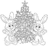 Rabbits and Christmas tree — Stock Vector