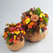 Halloween pumkin used as a vase for flowers — Stock Photo #54758833