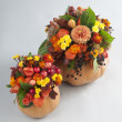 Halloween pumkin used as a vase for flowers — Stock Photo #54758861