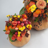 Halloween pumkin used as a vase for flowers — Stock Photo