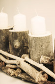 Wooden stand with candles — Stock Photo