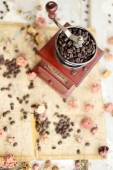 Coffee beans and dried roses — Стоковое фото