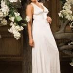 Bride in white dress in a garden — Stock Photo #53169209