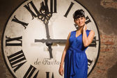 Woman on the background of a large clock face — Stock Photo