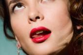 Tip of tongue licks lips — Stock Photo