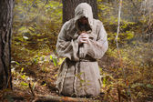 Monk in the misty forest — Stock Photo