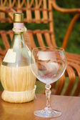 Bottle of wine and empty wine glass — Stock Photo