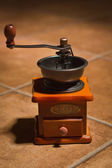 Old coffee grinder on a table — Stock Photo