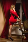 Fashionable lady in red dress — Stock Photo
