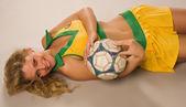 Beautiful sexy blond cheerleader whit soccer ball — Stock Photo