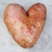 Potatoes in the form of heart — Stock Photo