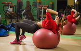 Fit woman exercising with a fit ball — Stock Photo