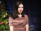 Brunette in the christmas interior — Stock Photo