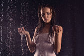 Sexy woman in white shirt posing under water — Stock Photo