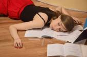 Lifeless college girl in a room — Stock Photo