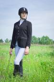 Beautiful girl jockey dressing uniform — Stock Photo