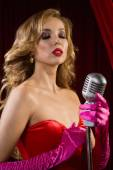 Retro singer sing holding vintage microphone — Stock Photo