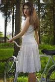 Happy young beautiful woman with retro bicycle — Stock Photo