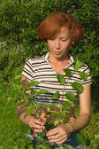 Happy female farmer gardening — Stock Photo