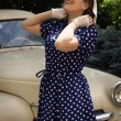 Lady in vintage dress standing near retro car — Stock Photo #82757810