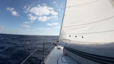 Sailing yacht on the race in blue sea — Stock Video