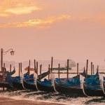 Venetian gondolas at sunrise in venice — Stock Photo #66197843