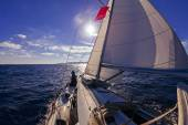 Sailing boat wide angle view in the sea at sunset — Stock Photo