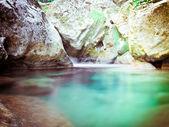 Mountain lake in stones — Stock Photo