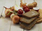Onion and bread — Stock Photo