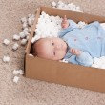 Newborn baby in open post box — Stock Photo #65165405