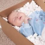 Newborn baby in open post box — Stock Photo #66223437