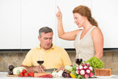 Mature couple in the kitchen — Photo