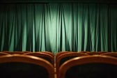 Theater stage green curtains — Stock Photo
