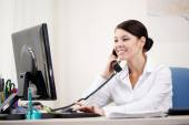 Businesswoman talking by phone — Stock Photo